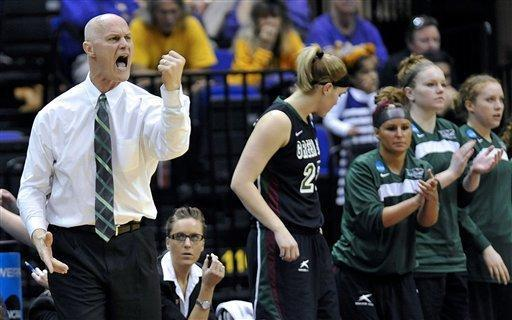 Green Bay head coach Kevin Borseth, left, reacts to a call during the first half of a first-round game against LSU in the women's NCAA college basketball tournament at the Pete Maravich Assembly Center in Baton Rouge, La., Sunday, March 24, 2013. (AP Photo/Bill Feig)