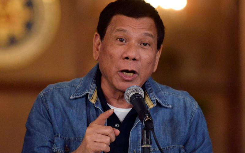 Philippine President Rodrigo Duterte gestures while speaking during a late night news conference - Reuters