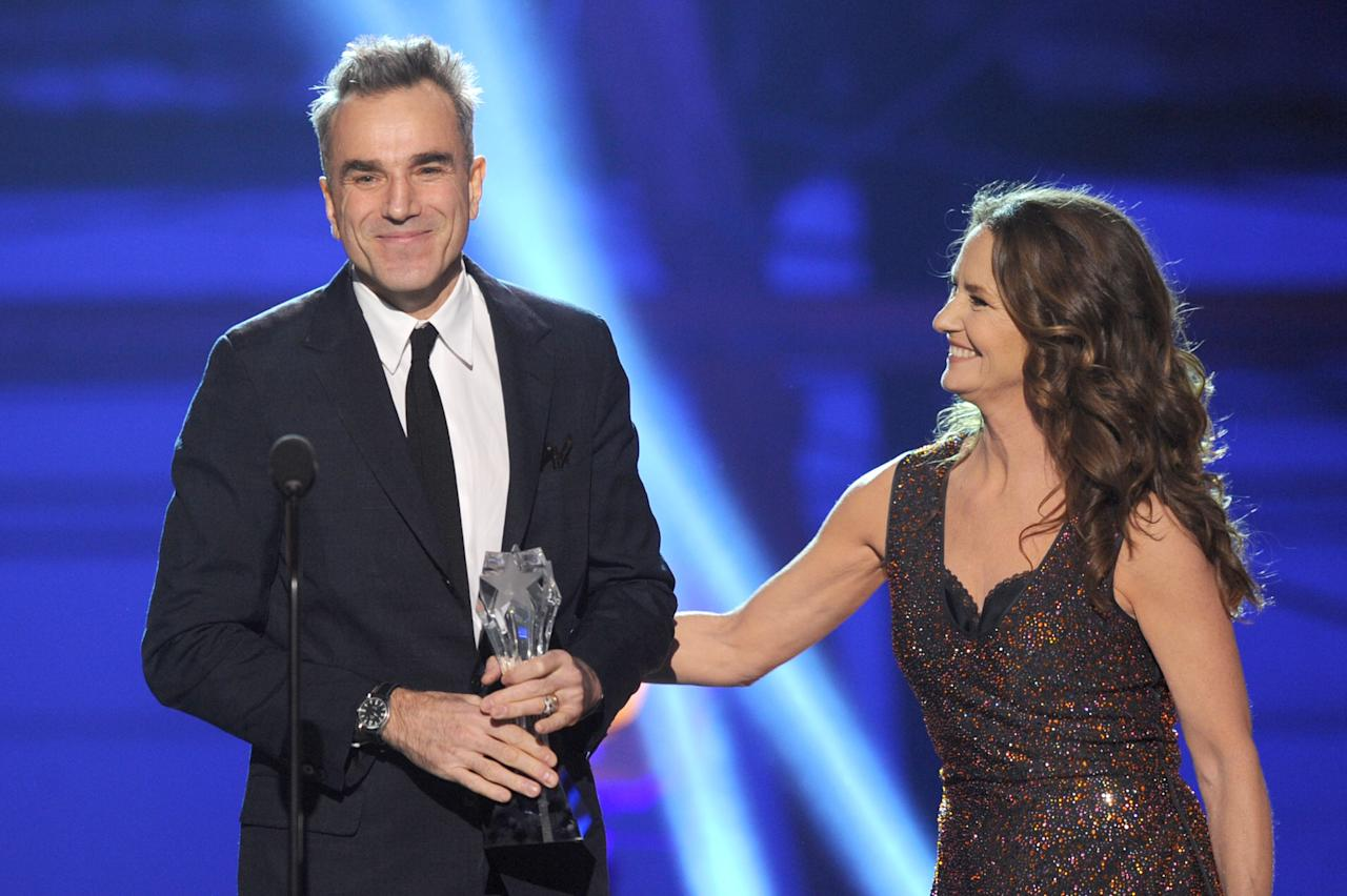 "SANTA MONICA, CA - JANUARY 10:  Presenter Melissa Leo (R) looks on as actor Daniel Day-Lewis accepts the Best Actor Award for ""Lincoln"" onstage at the 18th Annual Critics' Choice Movie Awards held at Barker Hangar on January 10, 2013 in Santa Monica, California.  (Photo by Kevin Winter/Getty Images)"