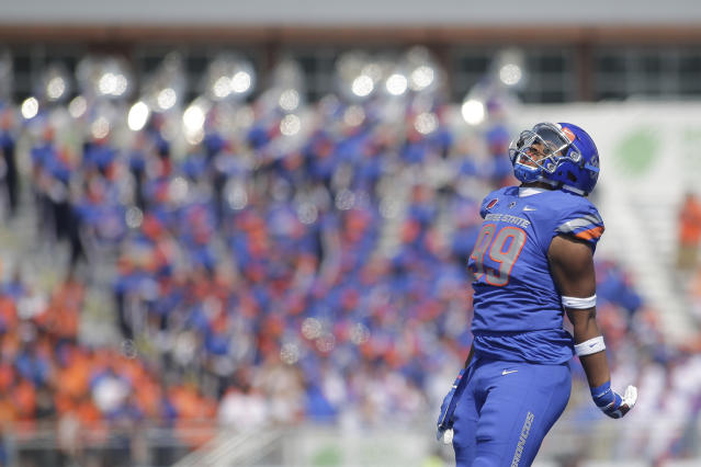 Boise State defensive end Curtis Weaver (99) led the Mountain West in sacks in 2017. (AP Photo/Otto Kitsinger)