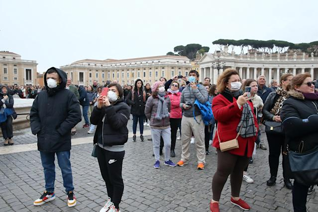Pilgrims arrive in St Peter's Square, Vatican City, for prayer with masks to protect themselves from the coronavirus. (Grzegorz Galazka/Mondadori Portfolio/Sipa USA)