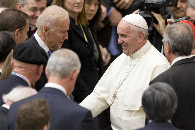 FILE - In this April 29, 2016, file photo, Vice President Joe Biden shakes hands with Pope Francis during a congress on the progress of regenerative medicine held at the Vatican. Biden has demonstrated a deep public connection to his Catholic faith, dating to the earliest days of his political career. (AP Photo/Andrew Medichini, File)