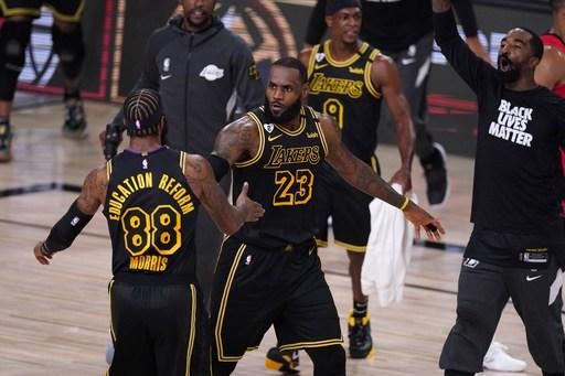 James, Davis help Lakers hold on to beat Rockets, tie series