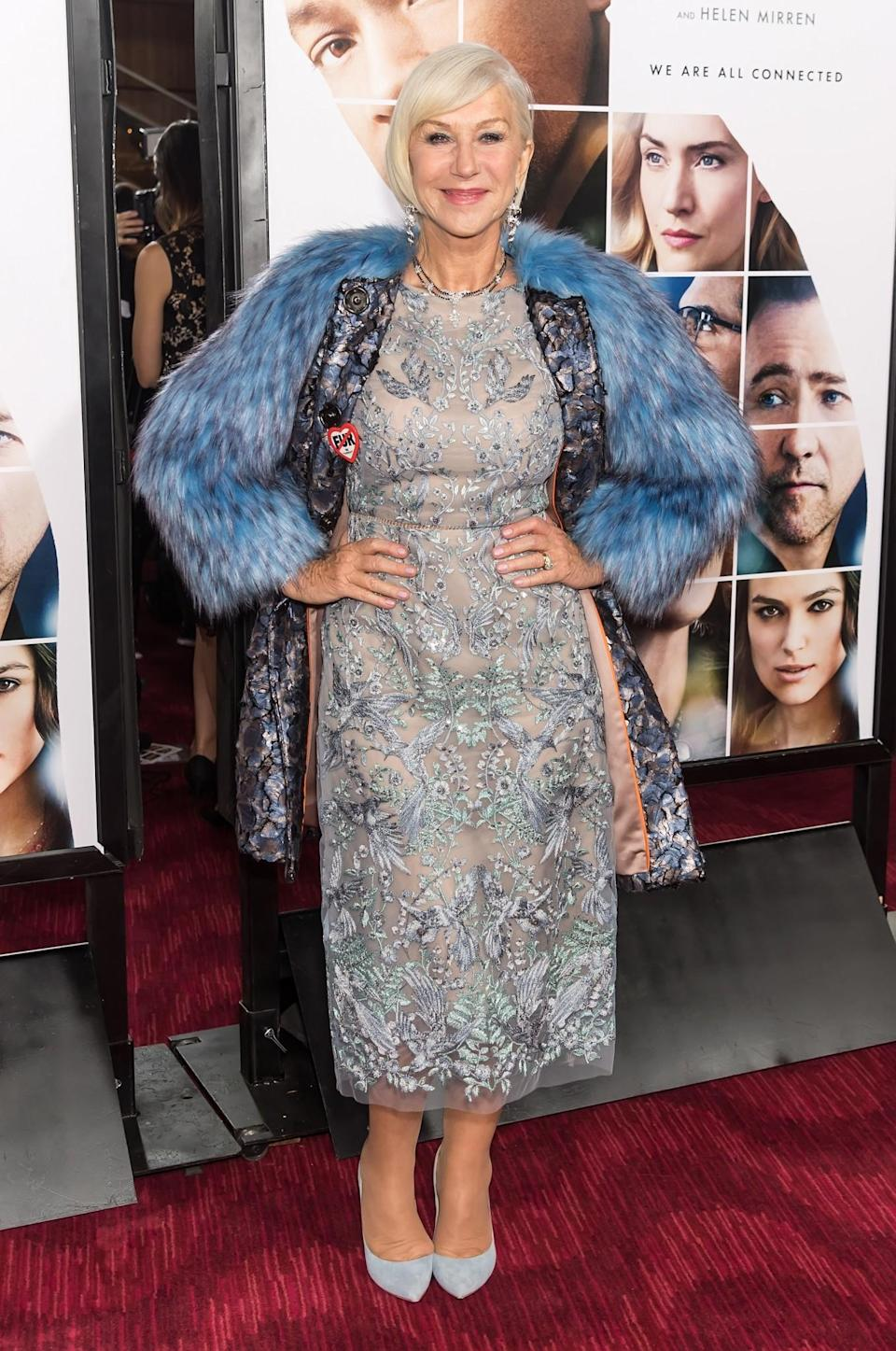 <p>Yet another excellent look from the Dame herself. A lace dress, paired with a faux fur coat and a big smile – what more could you want from a party look? [Photo: Getty] </p>