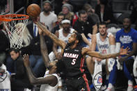 Miami Heat forward Derrick Jones Jr., right, grabs a rebound away from Los Angeles Clippers forward JaMychal Green during the first half of an NBA basketball game Wednesday, Feb. 5, 2020, in Los Angeles. (AP Photo/Mark J. Terrill)