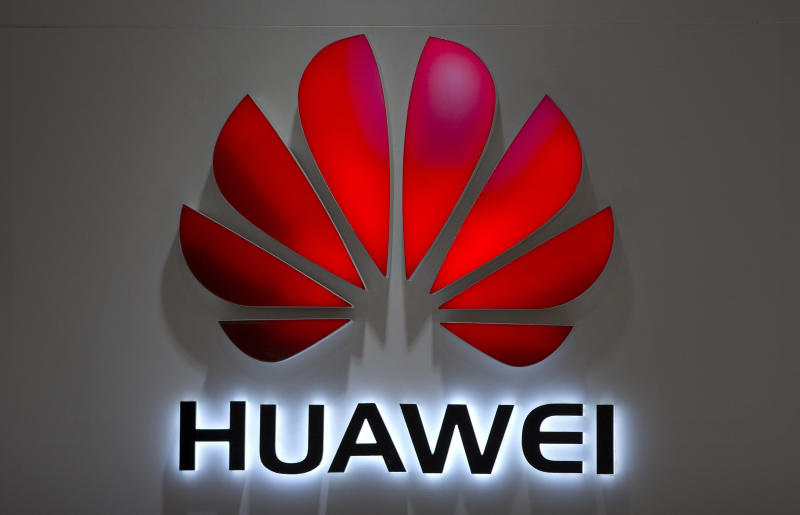 FILE - In this July 4, 2018, file photo, the Huawei logo is seen in a shopping mall in Beijing. China's latest propaganda broadside in its trade war with the U.S. features an unusual star: Trevor Noah of the Daily Show. A recent clip from the popular comedy tv show discussing Chinese equipment maker Huawei's dominance in 5G mobile technology ran on Chinese state broadcaster CCTV's national lunchtime news on Monday as part of a package of stories attacking the U.S. position in the ongoing trade war. (AP Photo/Mark Schiefelbein, File)