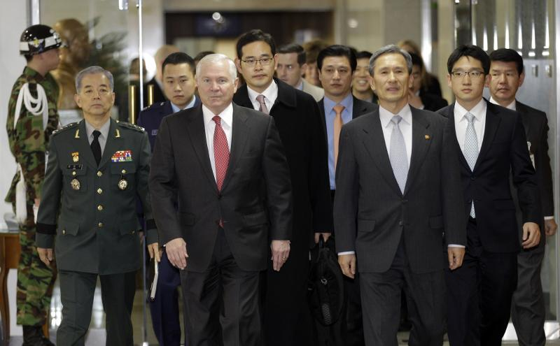 U.S. Defense Secretary Robert Gates, front left, and South Korean Defense Minister Kim Kwan-jin, front right, walk into the meeting room at the Defense Ministry in Seoul, South Korea, Friday, Jan. 14, 2011. North Korea is less able to invade South Korea now than it was a decade or more ago but has become a more lethal threat to Asia and the world, U.S. Defense Secretary Robert Gates said Friday.  (AP Photo/ Lee Jin-man, Pool)