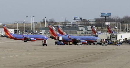 Several Souhtwest Airlines planes are lined up at the Lambert - St. Louis International Airport