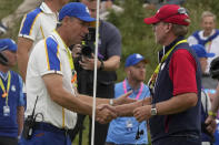 Team USA captain Steve Stricker shakes hands with Team Europe captain Padraig Harrington after the Ryder Cup matches at the Whistling Straits Golf Course Sunday, Sept. 26, 2021, in Sheboygan, Wis. (AP Photo/Charlie Neibergall)