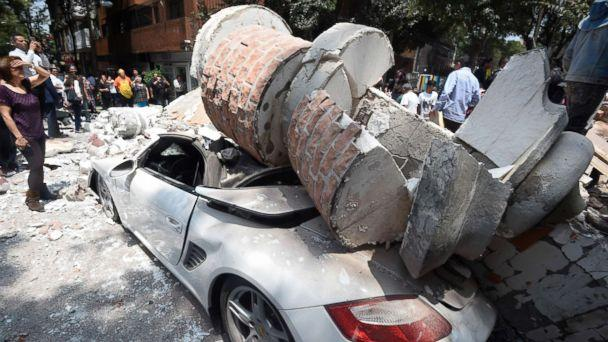 PHOTO: A car parked on the street in Mexico City sits under debris from a damaged building after a 7.1 earthquake rattled Mexico City on September 19, 2017. (Alfredo Estrella/AFP/Getty Images)