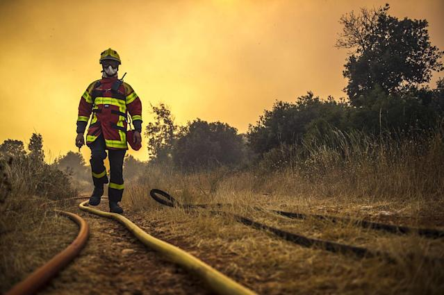 <p>The fire that burned 500 to 600 hectares of forest near Artigues in the Var, threatened homes on Tuesday. The firefighters stopped the progression of the fire that threatened homes in Seillons Source d'Argens, July 25, 2017. (Lilian Auffret/SIPA/REX/Shutterstock) </p>
