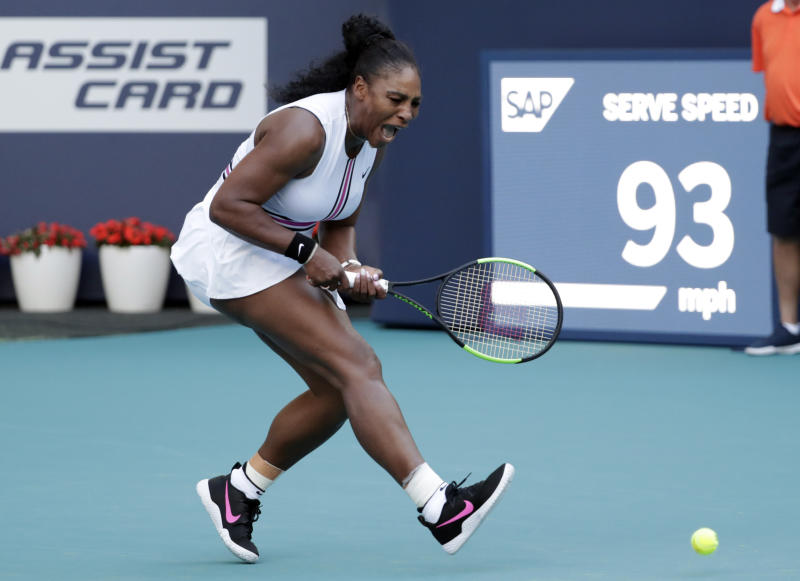 Serena Williams reacts as a ball hit by Rebecca Peterson, of Sweden, is out of bounds during the Miami Open tennis tournament, Friday, March 22, 2019, in Miami Gardens, Fla. (AP Photo/Lynne Sladky)