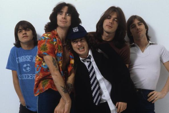 Malcolm Young, Bon Scott, Angus Young, Cliff Williams and Phil Rudd of Australian rock band AC/DC pose in London, England in August 1979.