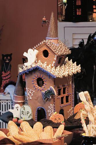 "<p>Why wait until Christmas to make a cookie house? This haunted cookie house also includes an assortment of cookies, candies, and chocolate.</p><p><em><a href=""https://www.womansday.com/food-recipes/food-drinks/a28860144/haunted-cookie-house-recipe/"" target=""_blank"">Get the recipe for Haunted Cookie House.</a></em></p>"