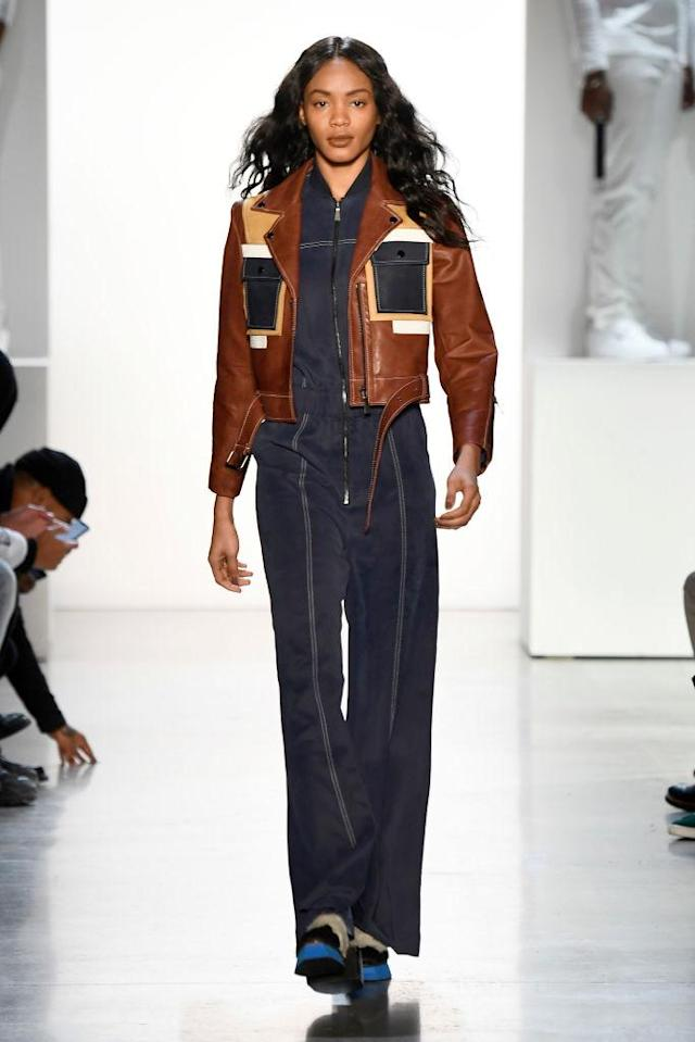 <p>Model wears boxy cropped leather jacket and jumpsuit at the Pyer Moss FW18 show. (Photo: Getty) </p>