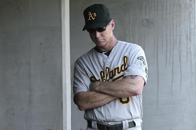 Oakland Athletics manager Bob Melvin stands in the dugout against the Detroit Tigers in the ninth inning of a baseball game in Detroit, Thursday, Aug. 29, 2013. The Tigers' Torii Hunter hit a walk off three-run home run to beat the Athletics 7-6. (AP Photo/Paul Sancya)
