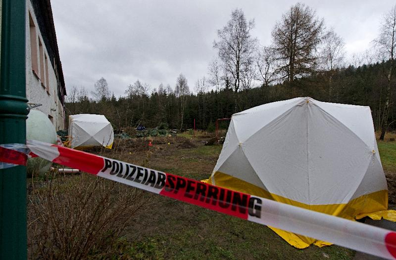 German police cordoned off Detlev Guenzel's house in Reichenau after discovering body parts in November 2013 (AFP Photo/Robert Michael)