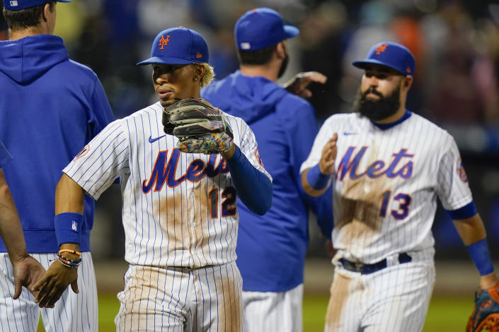 New York Mets' Francisco Lindor (12) and Luis Guillorme (13) celebrate with teammates after a baseball game against the Chicago Cubs, Monday, June 14, 2021, in New York. (AP Photo/Frank Franklin II)