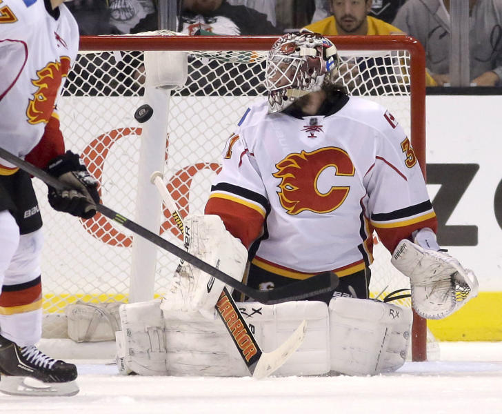 Calgary Flames goalie Karri Ramo watches a goal by Los Angeles Kings defenseman Drew Doughty during the first period of an NHL hockey game in Los Angeles, Monday, Oct. 21, 2013. (AP Photo/Chris Carlson)