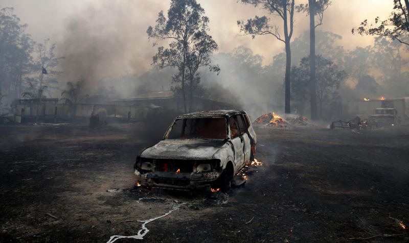 A burnt out car is seen at Possum Brush in the Mid North Coast region of NSW.