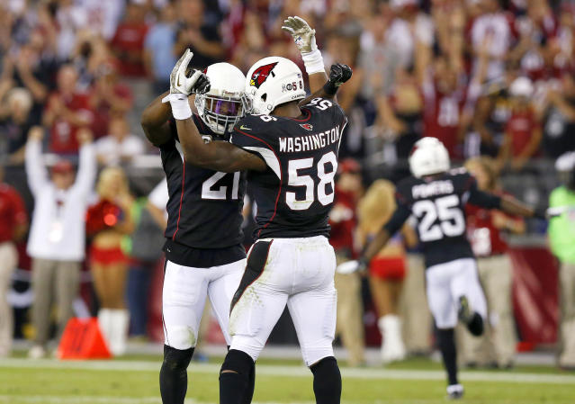 Arizona Cardinals' Daryl Washington (58), Patrick Peterson (21) and Jerraud Powers (25) celebrate a win against the Houston Texans in the closing moments of an NFL football game on Sunday, Nov. 10, 2013, in Glendale, Ariz. The Cardinals won 27-24. (AP Photo/Ross D. Franklin)