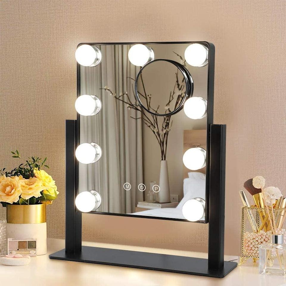 <p>The <span>Hollywood Depuley Plug-in Light Up Mirror with 9 Dimmer Led Bulbs</span> ($38) has a detachable 10 times magnification mirror, tri-color lighting modes, and smart touch.</p>