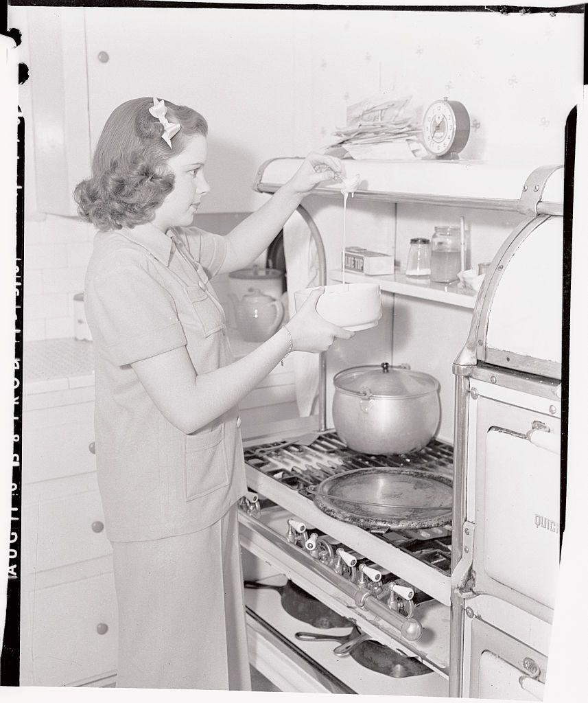 <p>This promotional photo shows Judy learning to make pancakes. According to the original caption, she was whipping these up before she went to the studio for the day. </p>