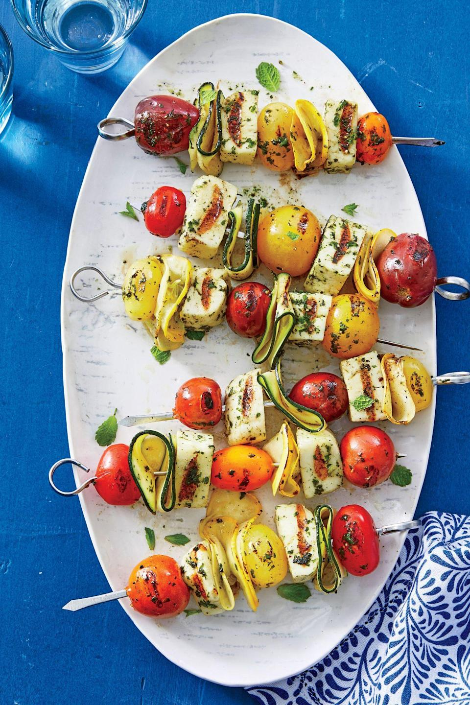 """<p>Firm <a href=""""https://www.southernliving.com/recipes/squash-halloumi-salad-recipe"""" rel=""""nofollow noopener"""" target=""""_blank"""" data-ylk=""""slk:Halloumi cheese"""" class=""""link rapid-noclick-resp"""">Halloumi cheese</a> holds up well on the grill and provides a nice contrast to the tender layers of squash on these vegetarian kebabs. Use a Y-shaped vegetable peeler to shave the squash into long, thin strips. Turn these kebabs into a quick <a href=""""https://www.southernliving.com/recipes/cornbread-panzanella-squash-recipe"""" rel=""""nofollow noopener"""" target=""""_blank"""" data-ylk=""""slk:panzanella"""" class=""""link rapid-noclick-resp"""">panzanella</a>. Removing the cooked ingredients from the skewers and toss with olive oil, lemon juice, and toasted bread cubes.</p>"""