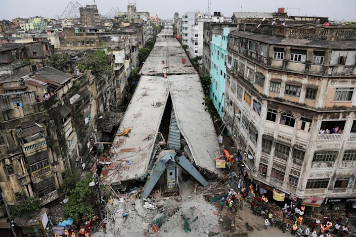 <p>APR. 1 2016 — General view shows a partially collapsed overpass in Kolkata, India. The overpass spanned nearly the width of the street and was designed to ease traffic through the densely crowded Bara Bazaar neighborhood in the capital of the east Indian state of West Bengal. About 100 meters (300 feet) of the overpass fell, while other sections remained standing. (Bikas Das/AP) </p>