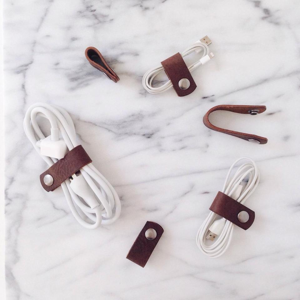 <p>There's no telling how or why cords tangle so easily. This <span>Leather Cord Organizer</span> ($20) comes to the rescue, saving you time untangling later on.</p>