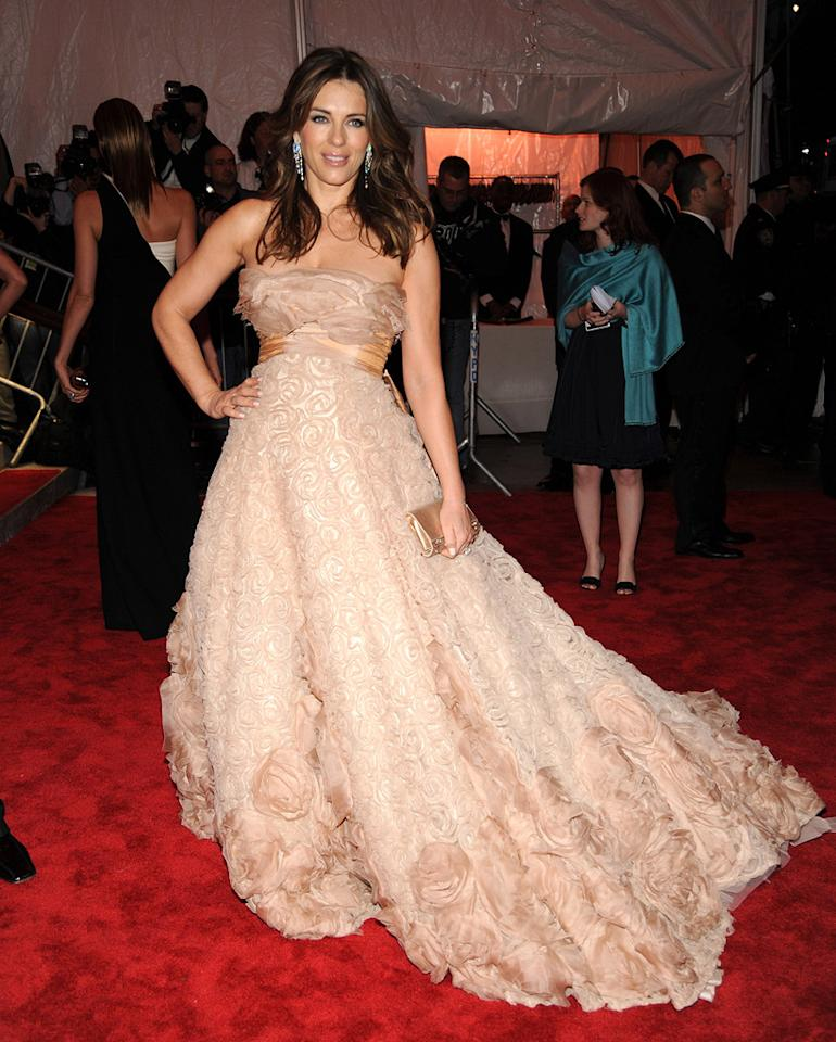 """Elizabeth Hurley struck a pose in a peach Elie Saab strapless gown adorned with rosettes. Kevin Mazur/<a href=""""http://www.wireimage.com"""" target=""""new"""">WireImage.com</a> - May 4, 2009"""