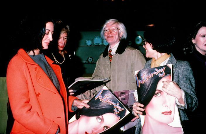 Andy Warhol celebrating Interview magazine's Paloma Picasso cover circa 1980.