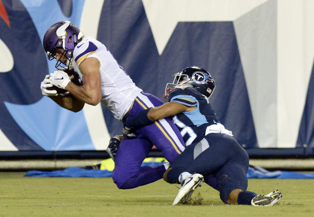 Minnesota Vikings wide receiver Brandon Zylstra, left, catches a 24-yard touchdown pass as he is defended by Tennessee Titans cornerback Trey Caldwell, right, in the second half of a preseason NFL football game Thursday, Aug. 30, 2018, in Nashville, Tenn. (AP Photo/Mark Zaleski)
