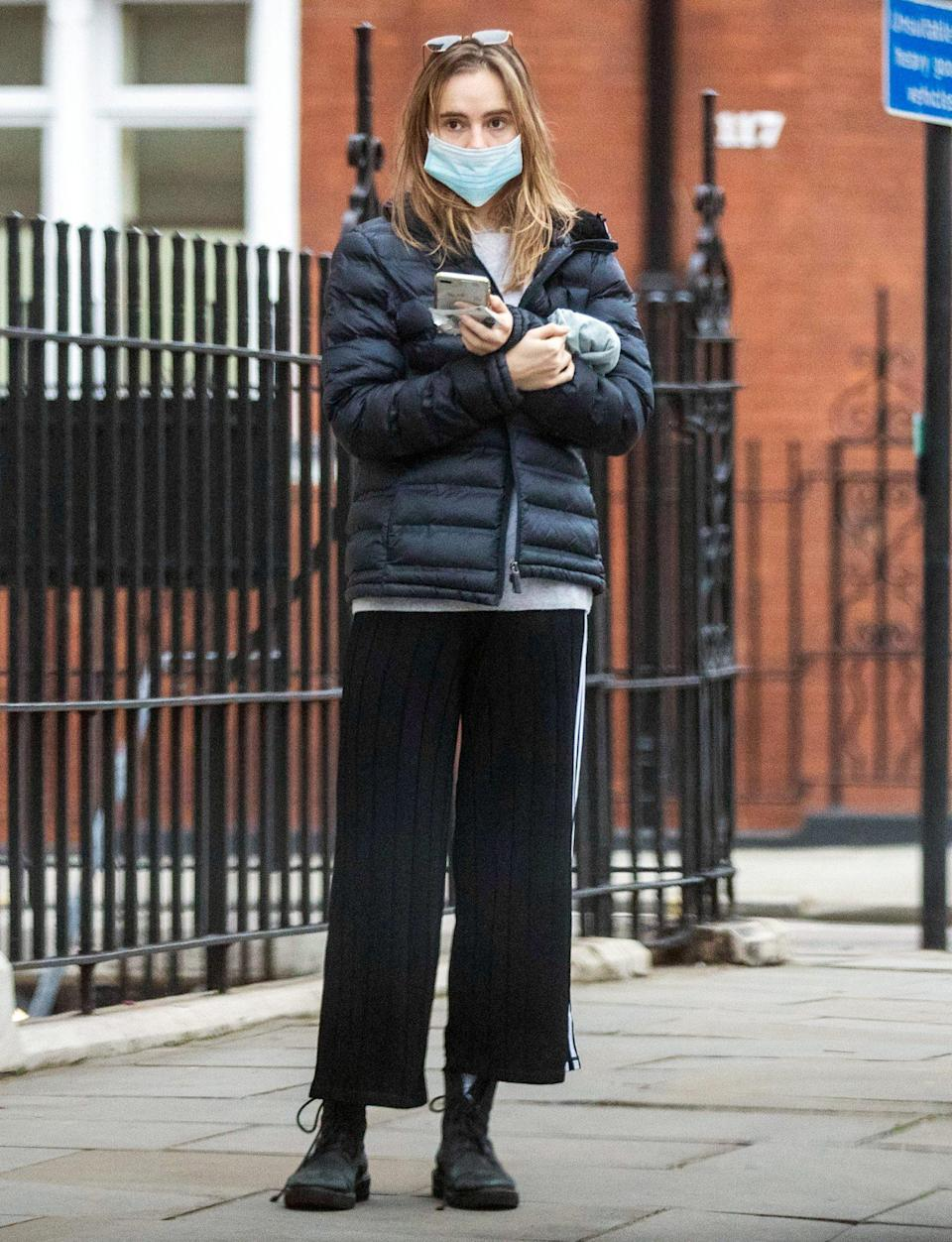 <p>Suki Waterhouse bundles up to run errands in London on Monday. </p>