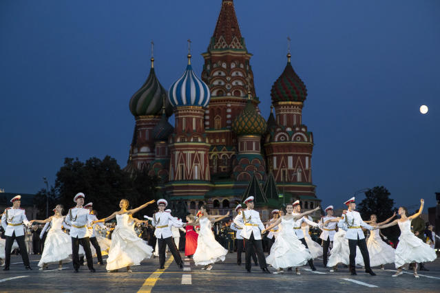 <p>Russian military band participants perform during a rehearsal of the Spasskaya Tower international military music festival in Red Square, in Moscow, Russia, late Thursday, Aug. 23, 2018, with the Saint Basil's Cathedral in the background. (AP Photo/Pavel Golovkin) </p>