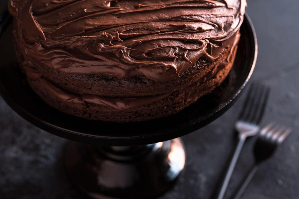 """<p>For the chocolate lovers in your life, try this recipe for a rich and indulgent birthday cake. Simply add sparklers or sprinkles for some color. </p><p><em><strong><a href=""""https://www.womansday.com/food-recipes/food-drinks/recipes/a10040/rich-chocolate-cake-121379/"""" rel=""""nofollow noopener"""" target=""""_blank"""" data-ylk=""""slk:Get the Rich Chocolate Cake recipe."""" class=""""link rapid-noclick-resp"""">Get the Rich Chocolate Cake recipe.</a></strong></em></p>"""