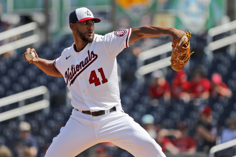 FILE - In a  Monday, March 2, 2020 file photo, Washington Nationals pitcher Joe Ross throws during the first inning of a spring training baseball game against the Miami Marlins, in West Palm Beach, Fla. Longtime infielder Ryan Zimmerman and pitcher Joe Ross are opting out of playing the 2020 season as Major League Baseball tries to get back amid the COVID-19 pandemic. General manager Mike Rizzo says the team is 100% supportive of Zimmerman and Ross deciding not to play.(AP Photo/Jeff Roberson, File)