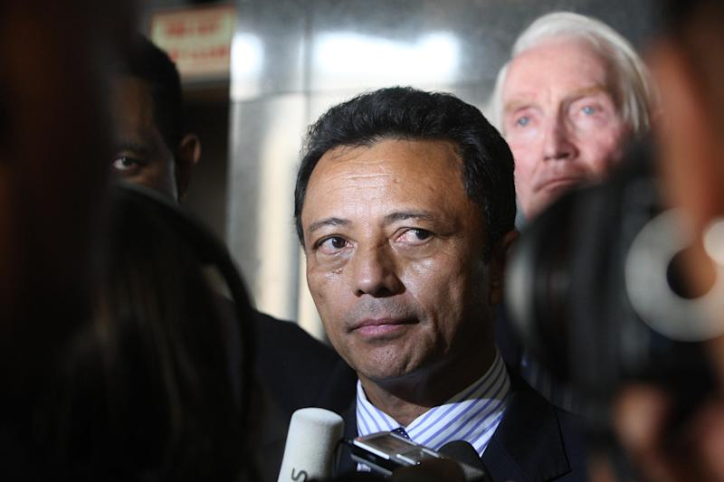 Madagascar's ousted leader Marc Ravalomanana addresses the press on January 21, 2012 as he leaves O. R Tambo international Airport in Johannesburg