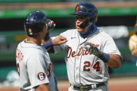Detroit Tigers' Miguel Cabrera, right celebrates with Jonathan Schoop after driving him in with a two run home run in the first inning of a baseball game against the Pittsburgh Pirates, Saturday, Aug. 8, 2020, in Pittsburgh. This was the second of four home run Pirates starter Derek Holland gave in the Tigers five run first. (AP Photo/Keith Srakocic)