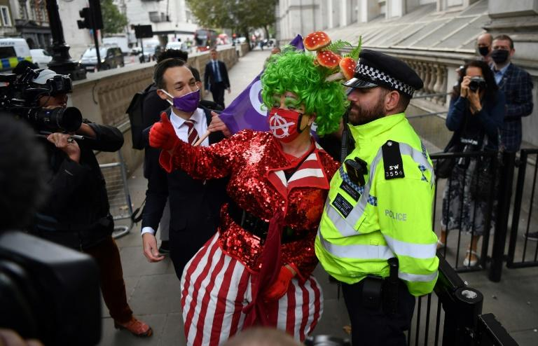 A pantomime dame poses outside Downing Street