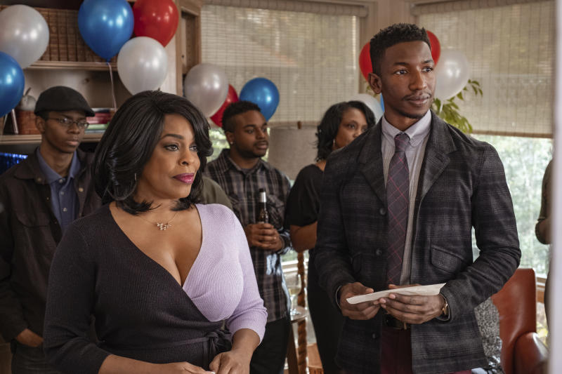 """This image released by Netflix shows Niecy Nash, left, and Mamoudou Athie in a scene from """"Uncorked."""" (Nina Robinson/Netflix via AP)"""