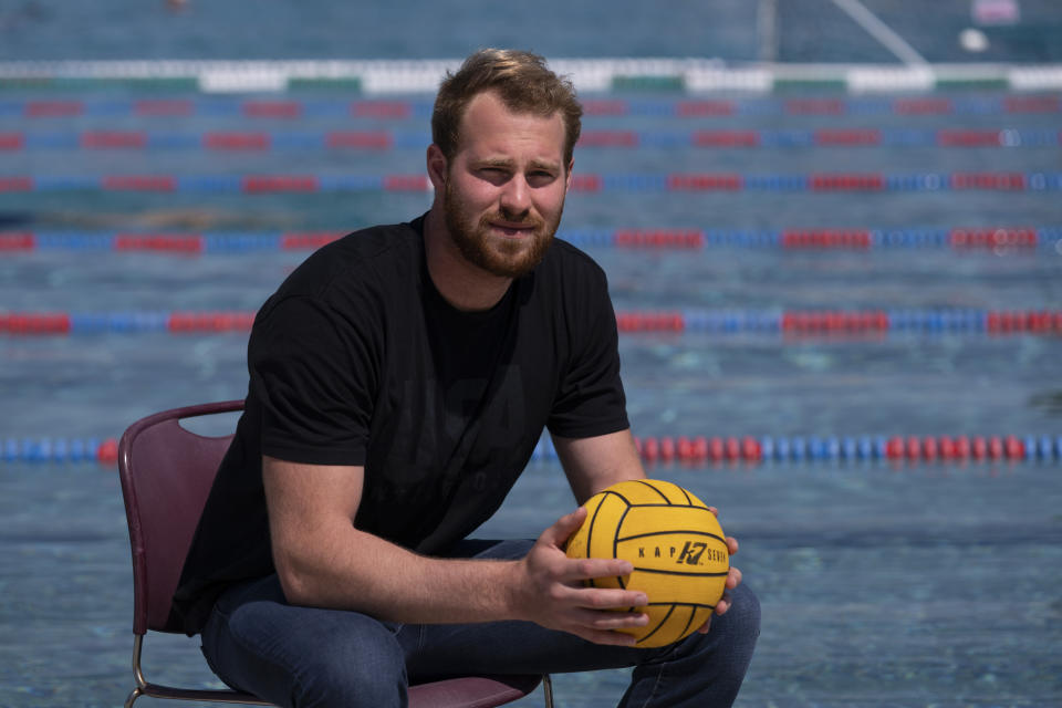 Water polo player Marko Vavic poses for photos at MWR Aquatic Training Center in Los Alamitos, Calif., Tuesday, April 27, 2021. Two years after his father, Jovan, was arrested as part of a college admissions investigation dubbed Operation Varsity Blues, Vavic is pushing for a spot on the U.S. men's Olympic water polo team. (AP Photo/Jae C. Hong)