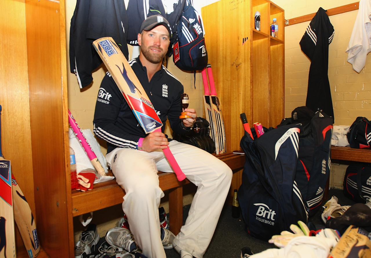 SYDNEY, AUSTRALIA - JANUARY 07:  Matt Prior of England celebrates in the dressing room with the ashes urn after winning the series 3-1 during day five of the Fifth Ashes Test match between Australia and England at Sydney Cricket Ground on January 7, 2011 in Sydney, Australia.  (Photo by Tom Shaw - Pool/Getty Images)