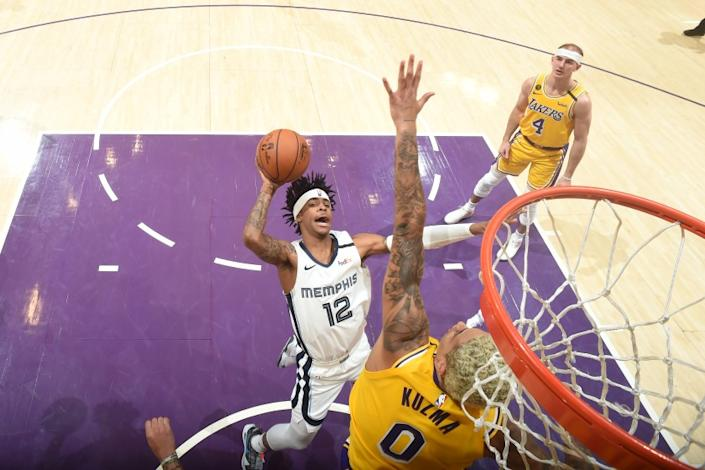 "Lakers forward Kyle Kuzma tries to block the shot of Memphis Grizzlies rookie Ja Morant on Feb. 21 at Staples Center. <span class=""copyright"">(Andrew D. Bernstein / NBAE via Getty Images)</span>"
