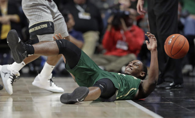 Charlotte's Jaylan McGill loses the ball as he falls out of bounds against Wake Forest in the first half of an NCAA college basketball game in Winston-Salem, N.C., Thursday, Dec. 6, 2018. (AP Photo/Chuck Burton)