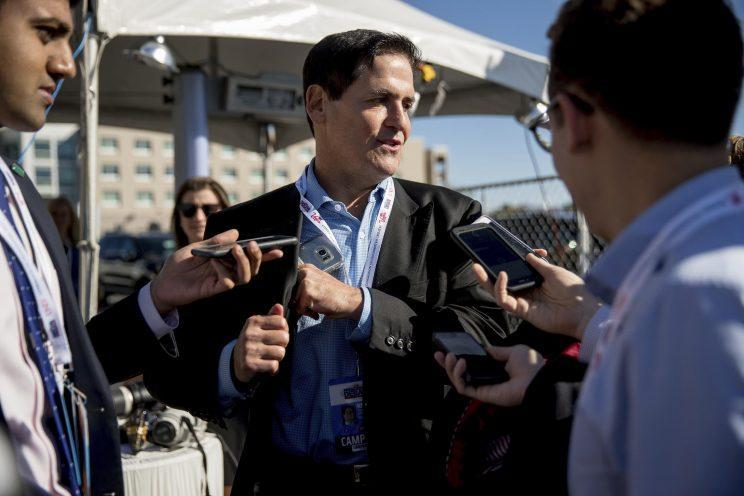 Mark Cuban stops to speak with members of the media as he arrives for the third presidential debate. (Photo: Andrew Harnik/AP)
