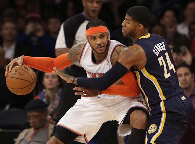 New York Knicks' Carmelo Anthony, left, tries to move around Indiana Pacers' Paul George during the first half of an NBA basketball game at Madison Square Garden on Wednesday, March 19, 2014, in New York. (AP Photo/Seth Wenig)