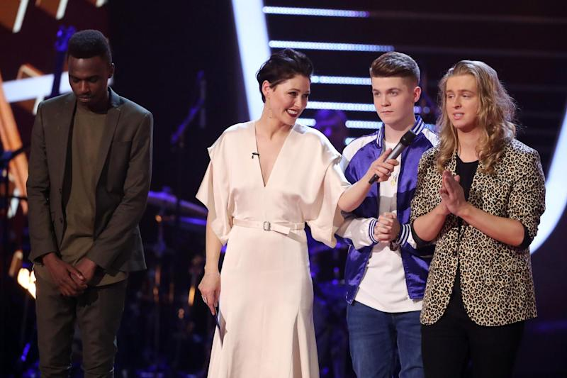 Results: Mo Adeniran, Jamie Miller and Jack Bruley celebrate their success with presenter Emma Willis: Rex Features