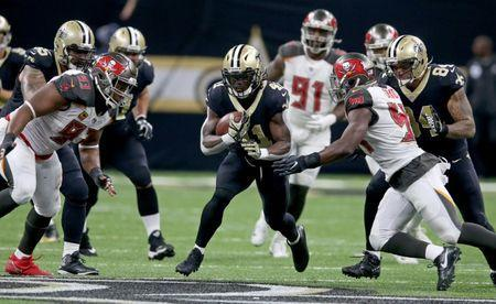 Nov 5, 2017; New Orleans, LA, USA; New Orleans Saints running back Alvin Kamara (41) runs with Tampa Bay Buccaneers defensive tackle Gerald McCoy (93) and outside linebacker Lavonte David (54) defending in the second half at the Mercedes-Benz Superdome. The Saints won, 30-10. Chuck Cook-USA TODAY Sports