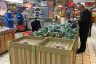 Customer shops for vegetables at a supermarket in Wuhan, the epicentre of the novel coronavirus outbreak